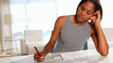 020813-national-money-monday-women-woman-saving-finances-financial-check-writing